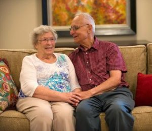 couple-sitting-together-on-couch-smiling-340